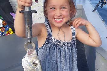 Evie and her Trevally while estuary fishing